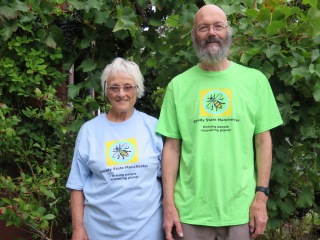 Blue and green tee-shirts, modelled